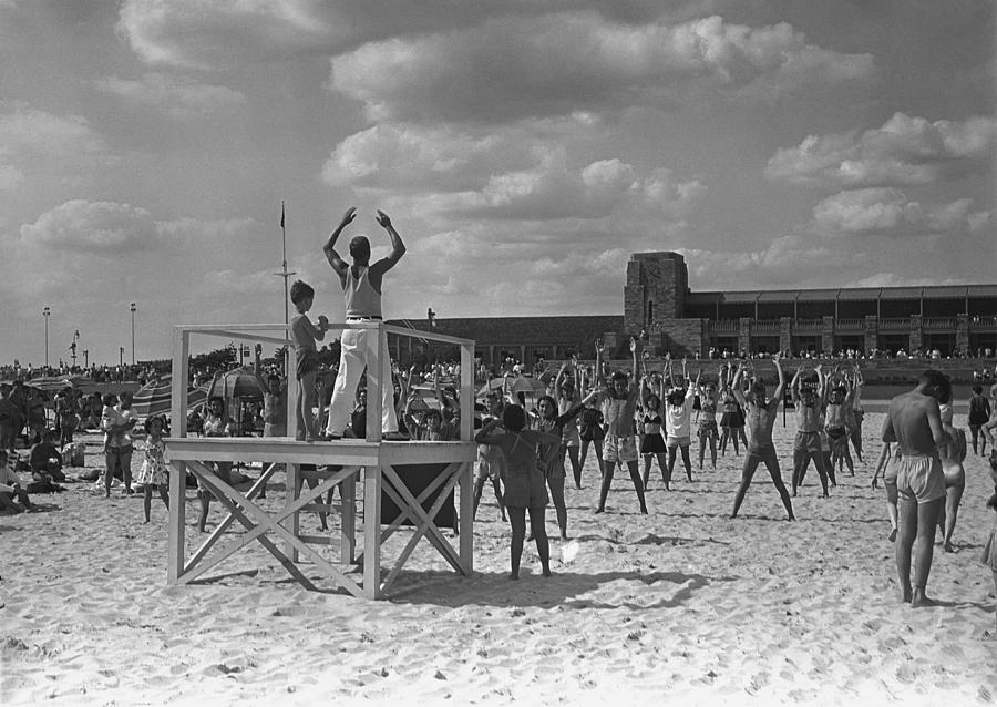 Adults Only Photograph - Group Of People Exercising On Beach, (b&w) by George Marks