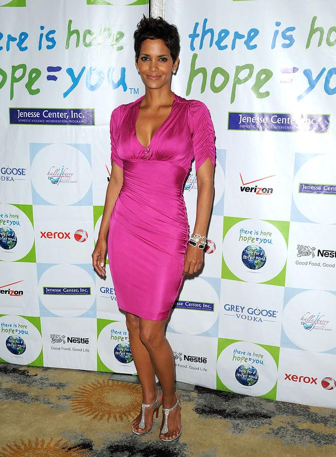 Halle Berry Photograph - Halle Berry Wearing A Dress By Roberto by Everett
