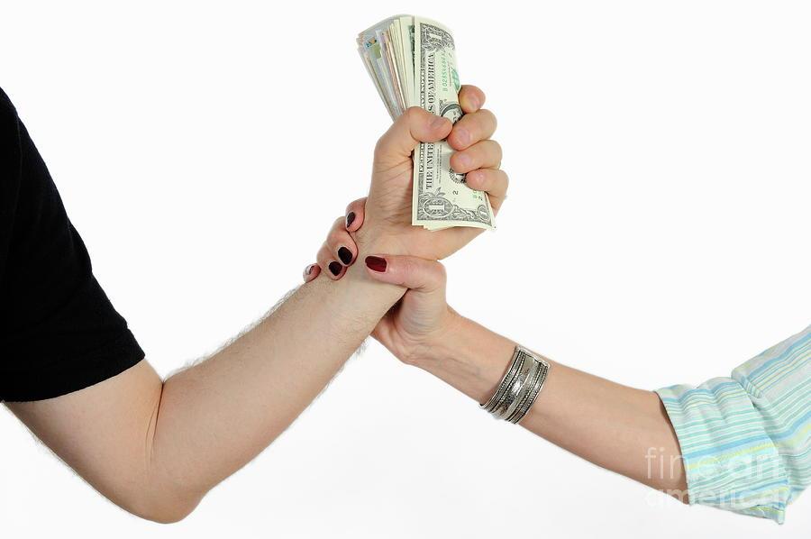 hand grabbing man s fistful of money photograph by sami sarkis