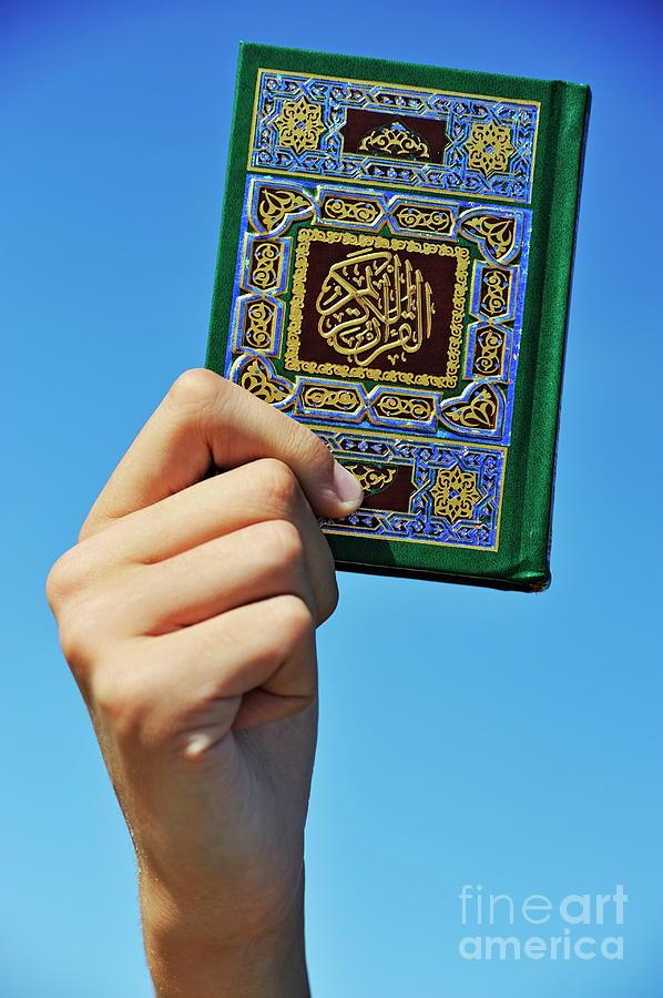 Hand Holding The Koran Book Photograph By Sami Sarkis