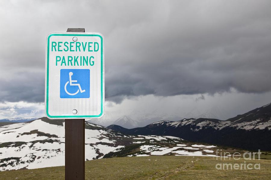Cloudy Photograph - Handicap Parking Sign At A National Park by Bryan Mullennix