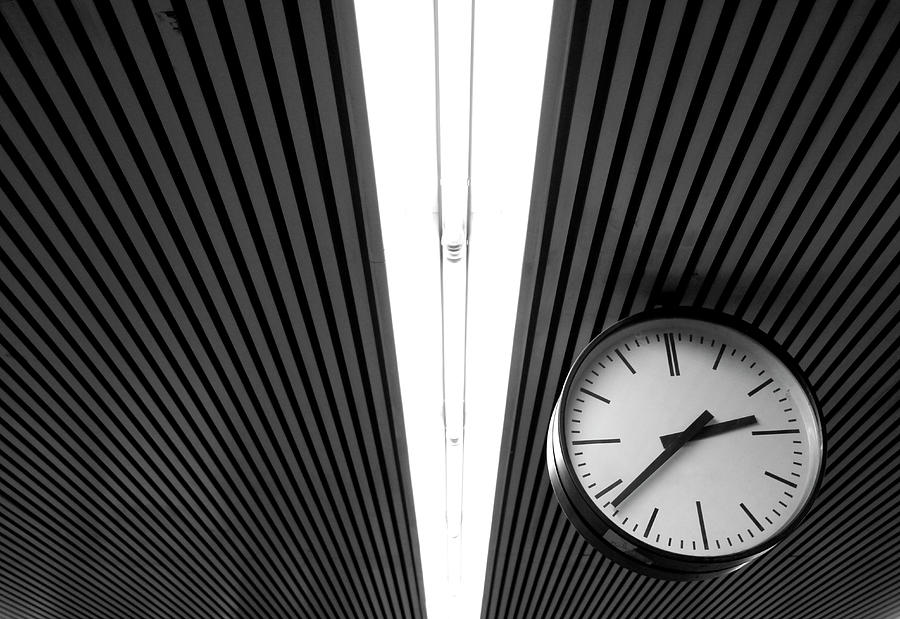 Horizontal Photograph - Hanging Clock by Christoph Hetzmannseder