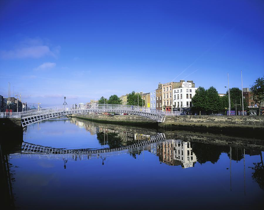 Blue Sky Photograph - Hapenny Bridge, River Liffey, Dublin by The Irish Image Collection