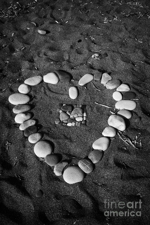 Aphrodites Photograph - Heart Symbol Made Out Of Pebbles On The Beach At Aphrodites Rock Petra Tou Romiou Cyprus by Joe Fox