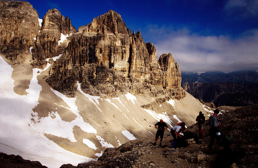 Adult Photograph - Hikers Resting At Bamberger Saddle, Gruppo Sella, Dolomites, Italy by Witold Skrypczak