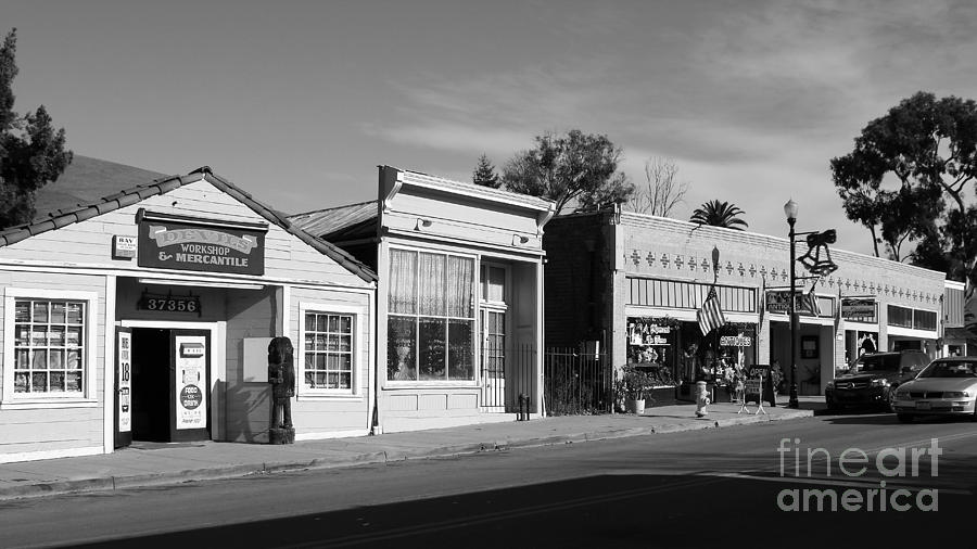 Black And White Photograph - Historic Niles District In California Near Fremont . Main Street . Niles Boulevard . 7d10676  . Bw by Wingsdomain Art and Photography
