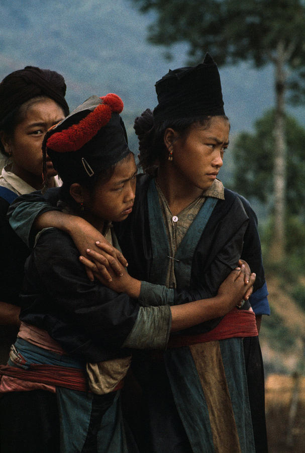 Color Image Photograph - Hmong Girls Cling To Each Other by W.E. Garrett