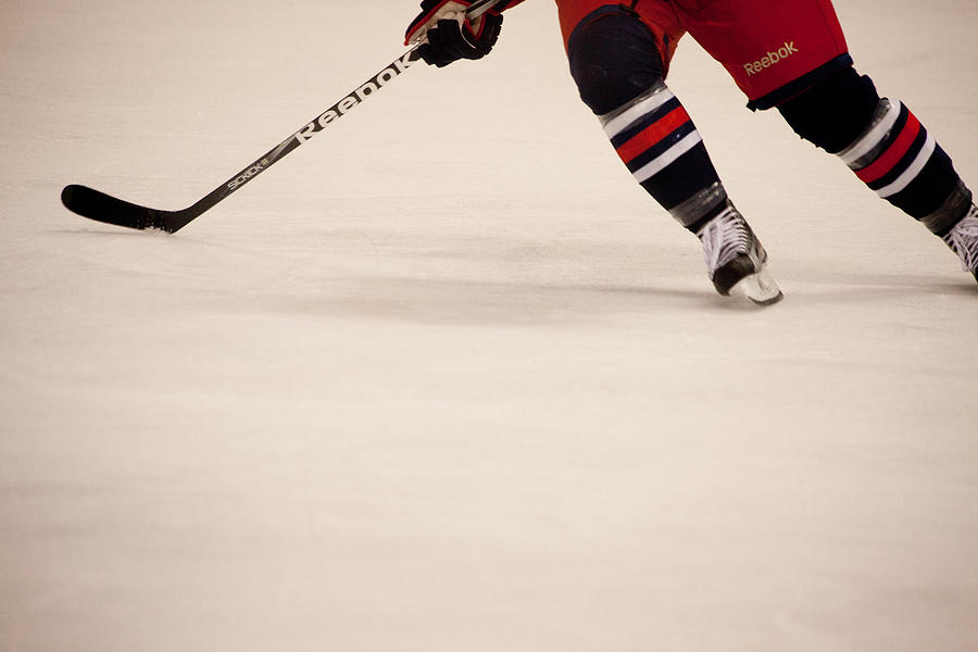 Hockey Photograph - Hockey Stride by Karol Livote