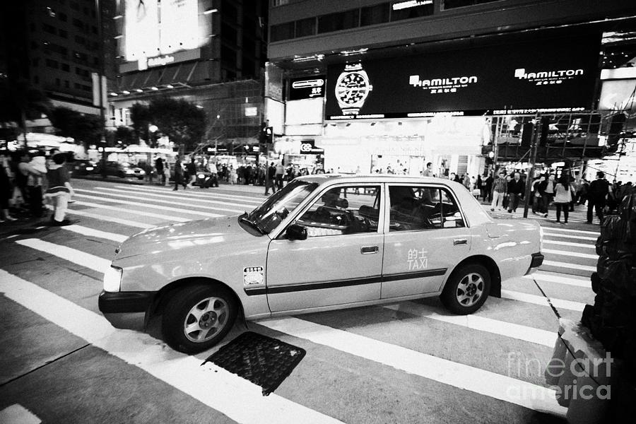 Hong Kong Photograph - Hong Kong Red Taxi At Night On Nathan Road Downtown Kowloon Hong Kong Hksar China by Joe Fox