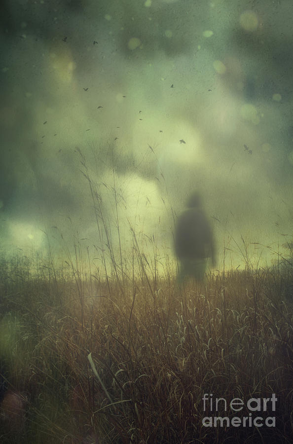Atmosphere Photograph - Hooded Man Walking In Field With Storm Clouds by Sandra Cunningham