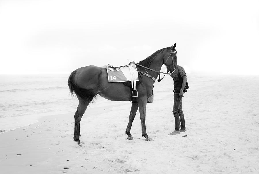 Boy Photograph - Horse And Man On The Beach Black And White by Kittipan Boonsopit