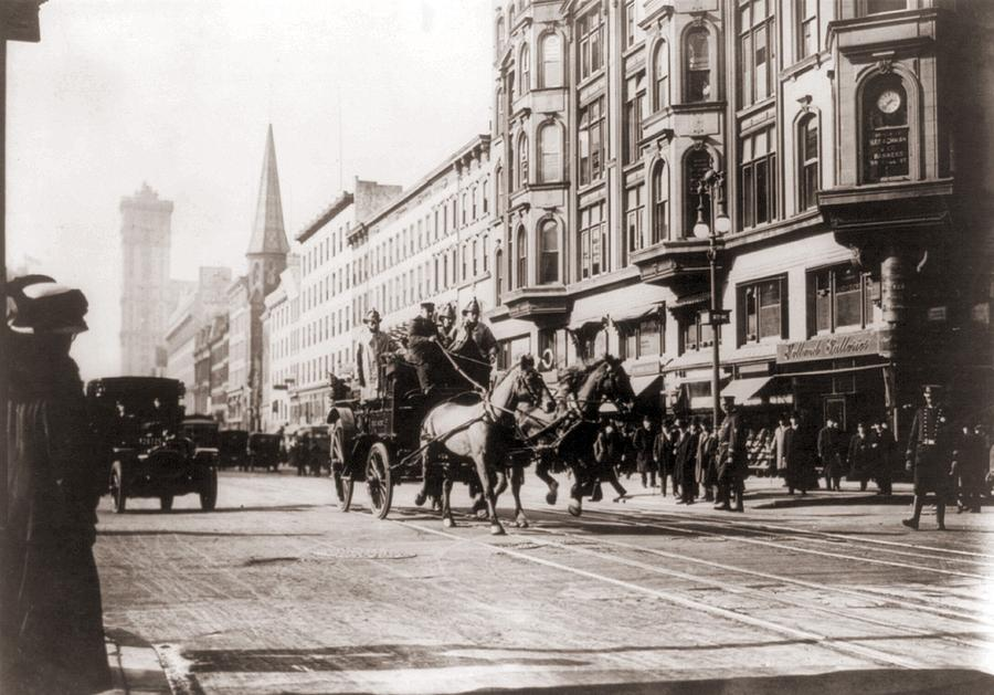 History Photograph - Horse-drawn Fire Engines In Street by Everett
