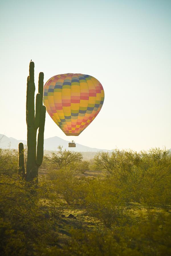 Arizona Photograph - Hot Air Balloon Over The Arizona Desert With Giant Saguaro Cactu by James BO  Insogna