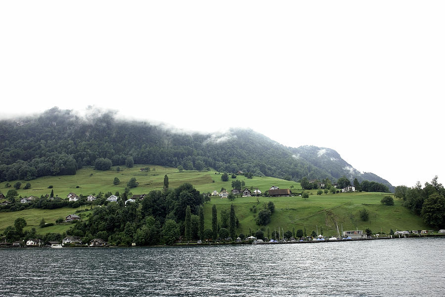 Action Photograph - Houses On The Greenery Of The Slope Of A Mountain Next To Lake Lucerne by Ashish Agarwal