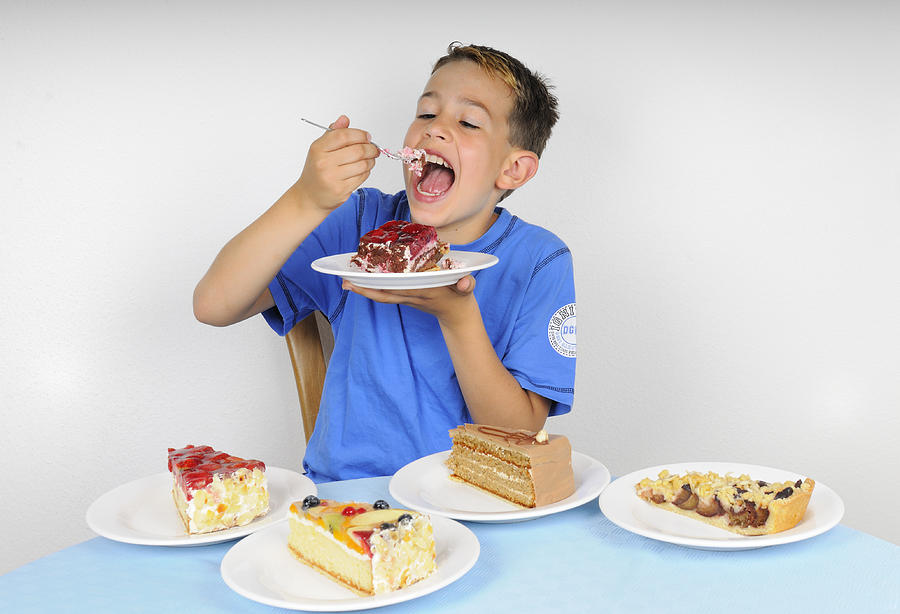 Cake Photograph - Hungry Boy Eating Lot Of Cake by Matthias Hauser