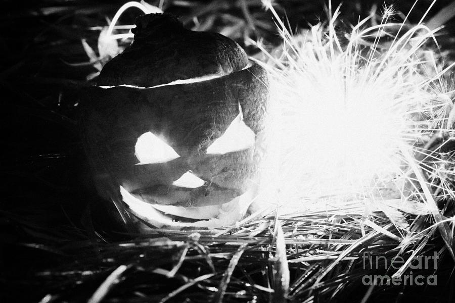 Halloween Photograph - Illuminated Halloween Turnip Jack-o-lantern With Sparkler To Ward Off Evil Spirits by Joe Fox