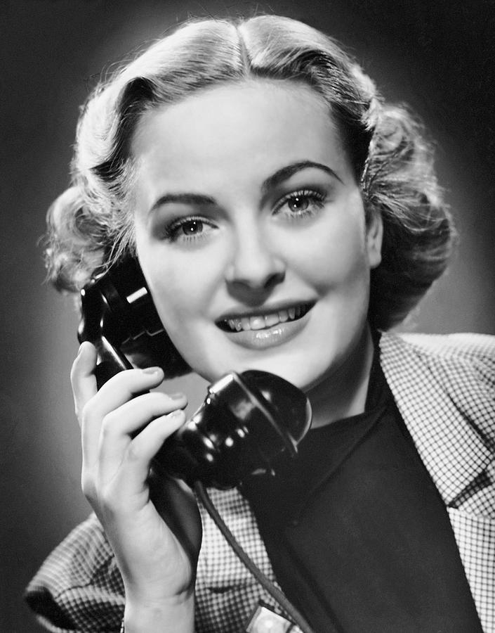 Adult Photograph - Indoor Portrait Of Woman On Telephone by George Marks