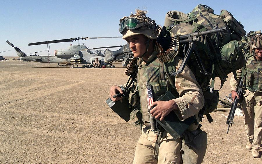 Infantryman Carries A Full Combat Load Photograph By Everett