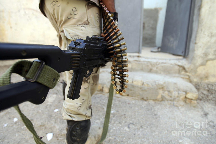 Iraqi Soldiers Carrying Machine Guns Photograph