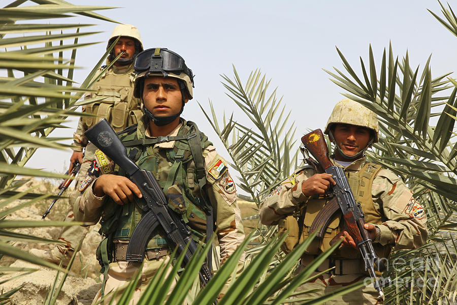 Iraq Photograph - Iraqi Soldiers Conduct A Foot Patrol by Stocktrek Images