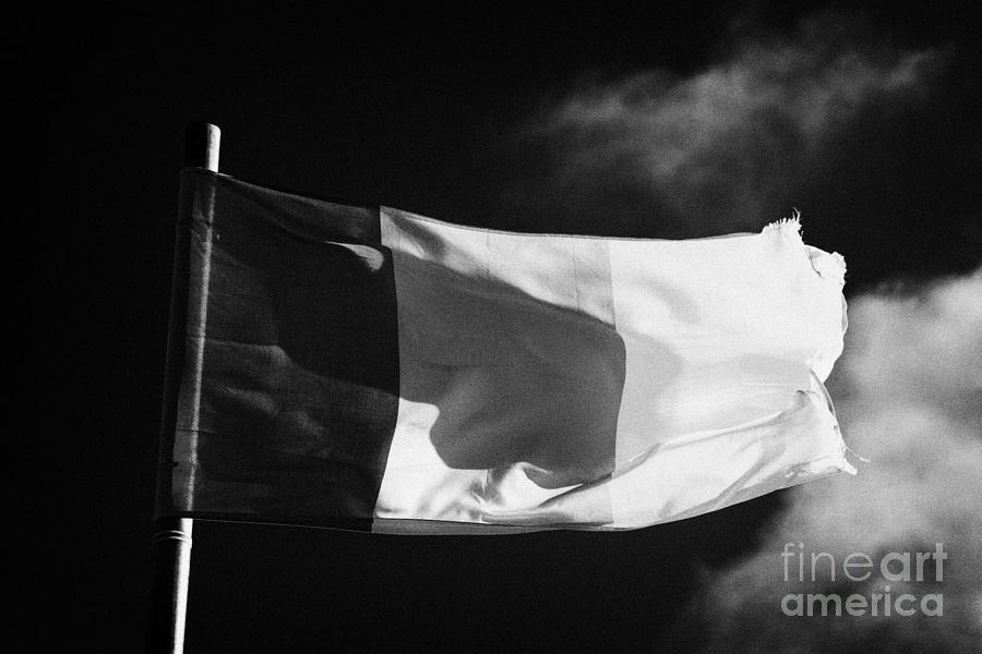 Republic Photograph - Irish Tricolour Flag With Frayed Edges Flying In Republic Of Ireland by Joe Fox