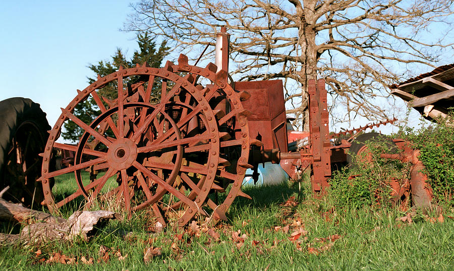 Old Metal Wheels With Tractor : Iron tractor wheels photograph by grant groberg