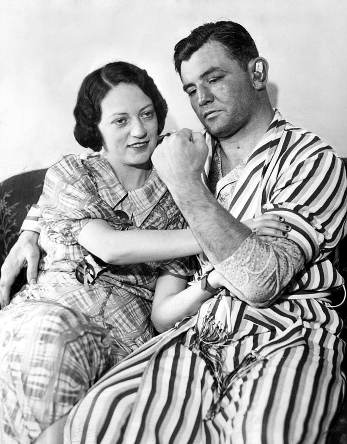 1930s Candid Photograph - James Braddock Shows Off To Wife May by Everett