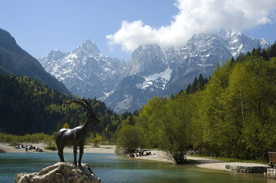 Horizontal Photograph - Jasna Lake In Julian Alps With Statue Of Mythical Chamois Zlatorog by John Elk III