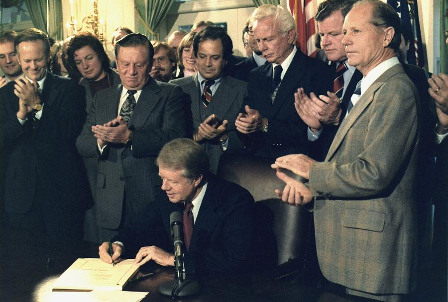History Photograph - Jimmy Carter Signs Airline Deregulation by Everett