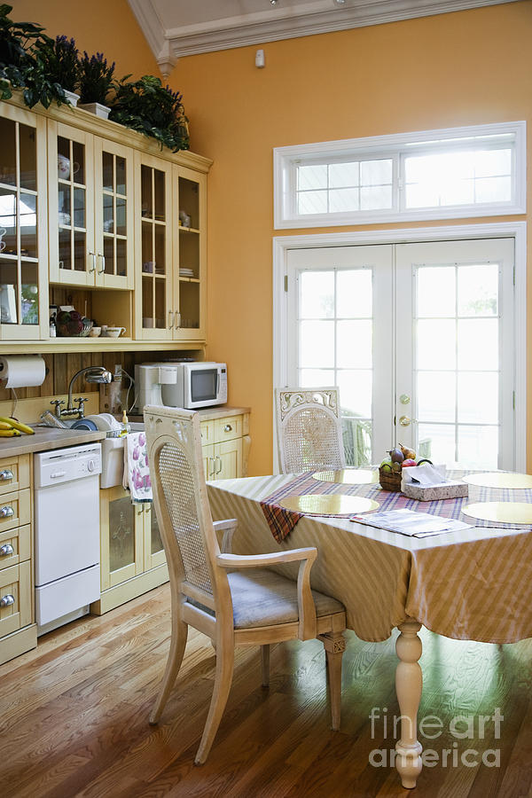 Appliances Photograph - Kitchen Cabinets And Table by Andersen Ross