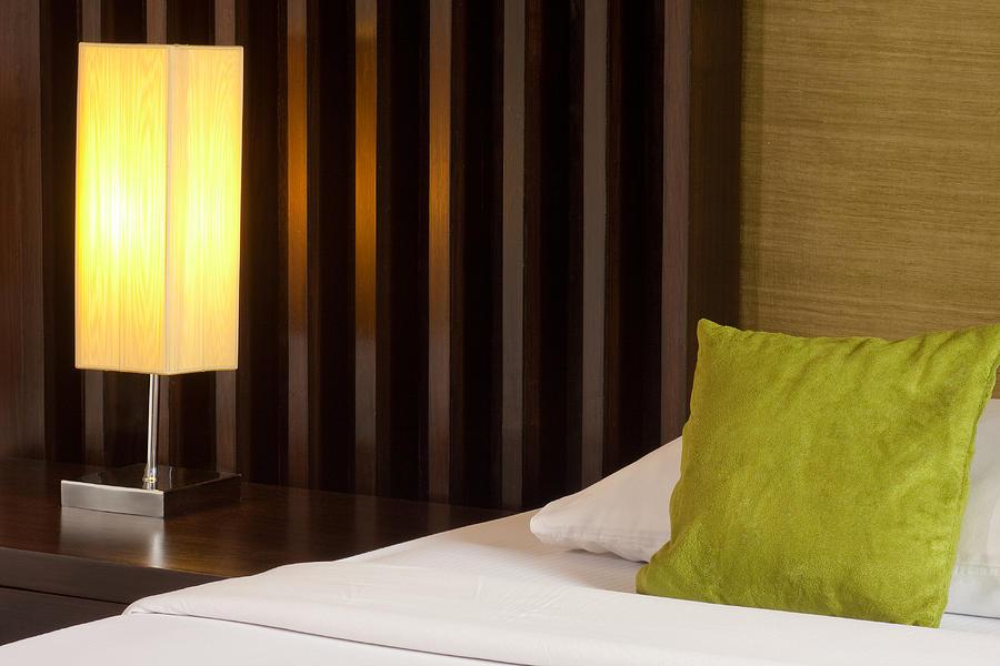 Hotel Photograph - Lamp And Bed by Atiketta Sangasaeng