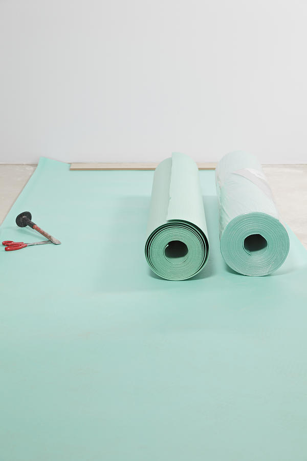 Nobody Photograph - Laying A Floor. Rolls Of Underlay Or by Magomed Magomedagaev