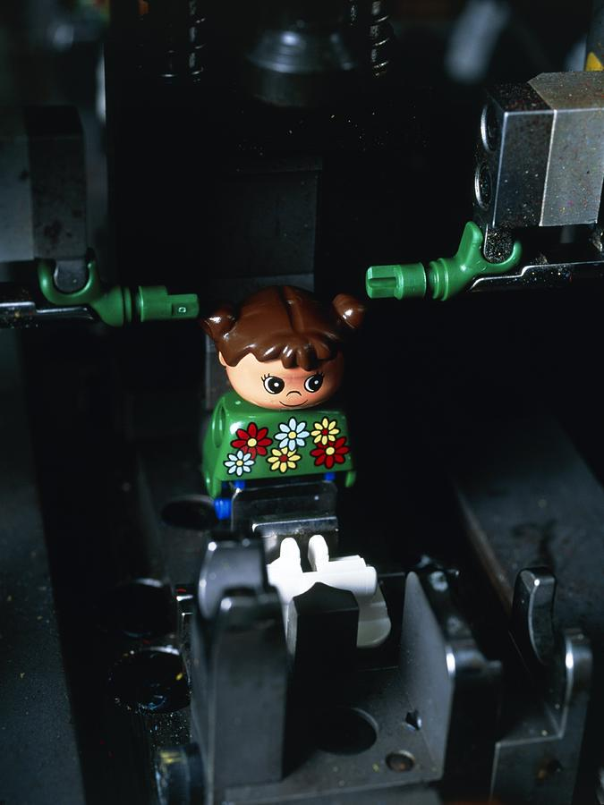 Assembly Photograph - Lego Doll In An Assembly Machine by Volker Steger