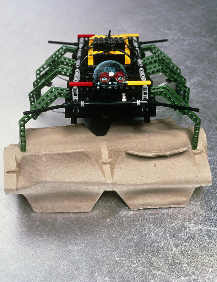 Robot Spider Photograph - Lego Robot Spider Climbing Over A Box by Volker Steger