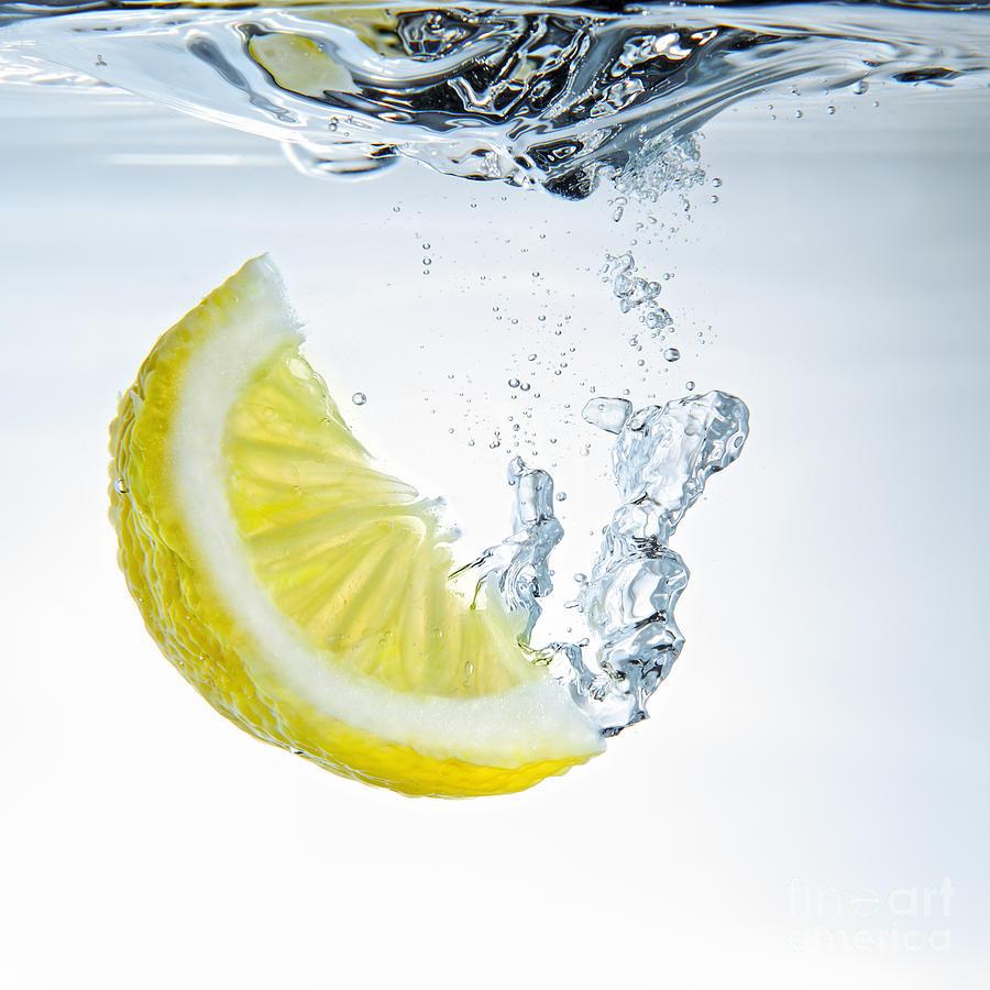 Water Photograph - Lemon Water by Silvio Schoisswohl