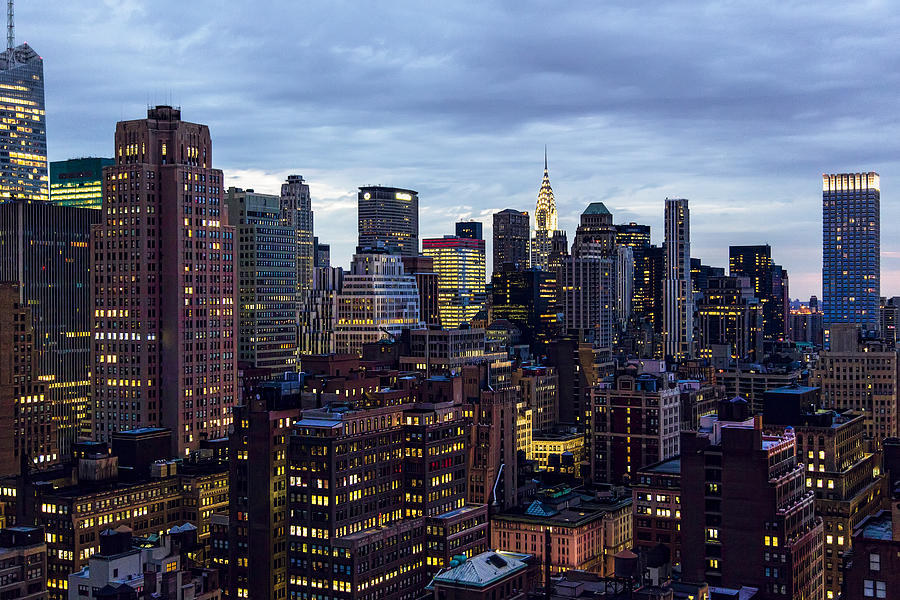Buildings Photograph - Life In The Big City by Janet Fikar