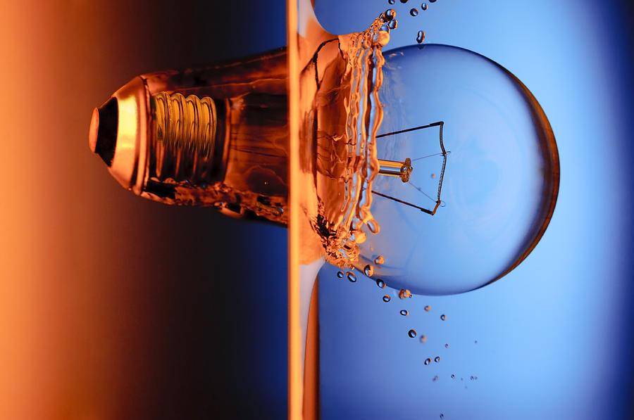 Arts Photograph - Light Bulb Shot Into Water by Setsiri Silapasuwanchai