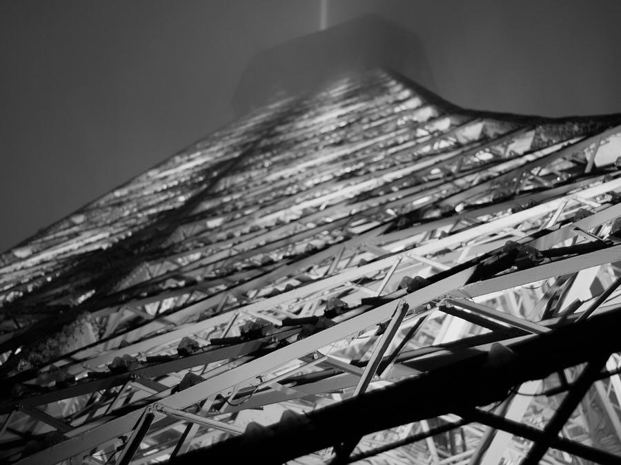 Paris Photograph - Lit And Looming by Humberto Laviera