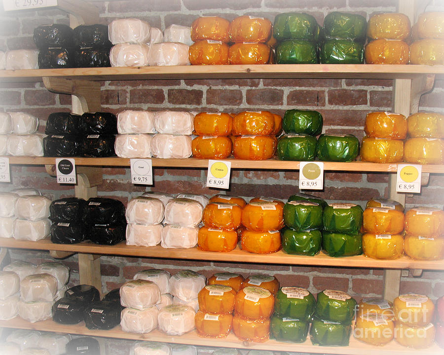 Travel Photograph - Little Cheeses On A Shelf In Amsterdam by Trude Janssen