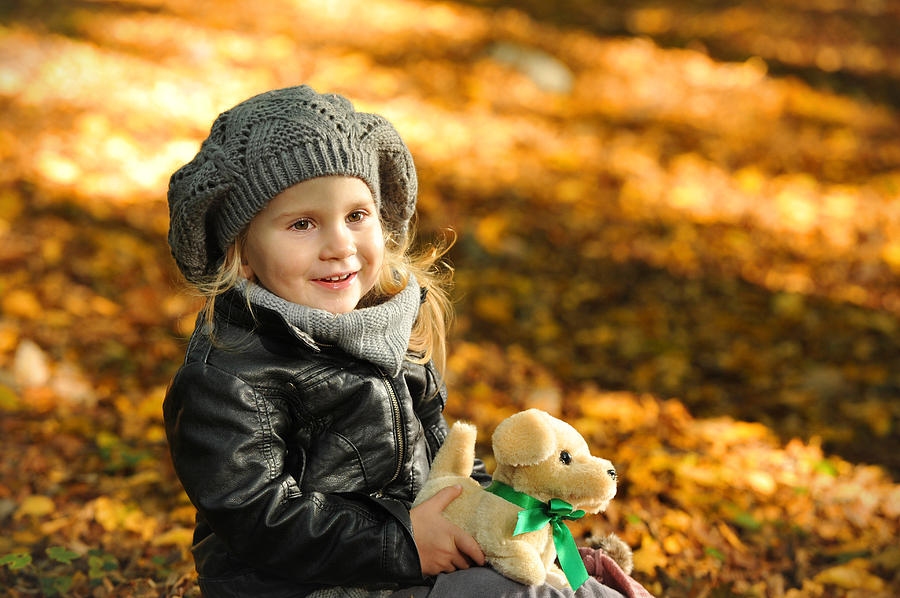 Adorable Photograph - Little Girl In Autumn Leaves by Waldek Dabrowski