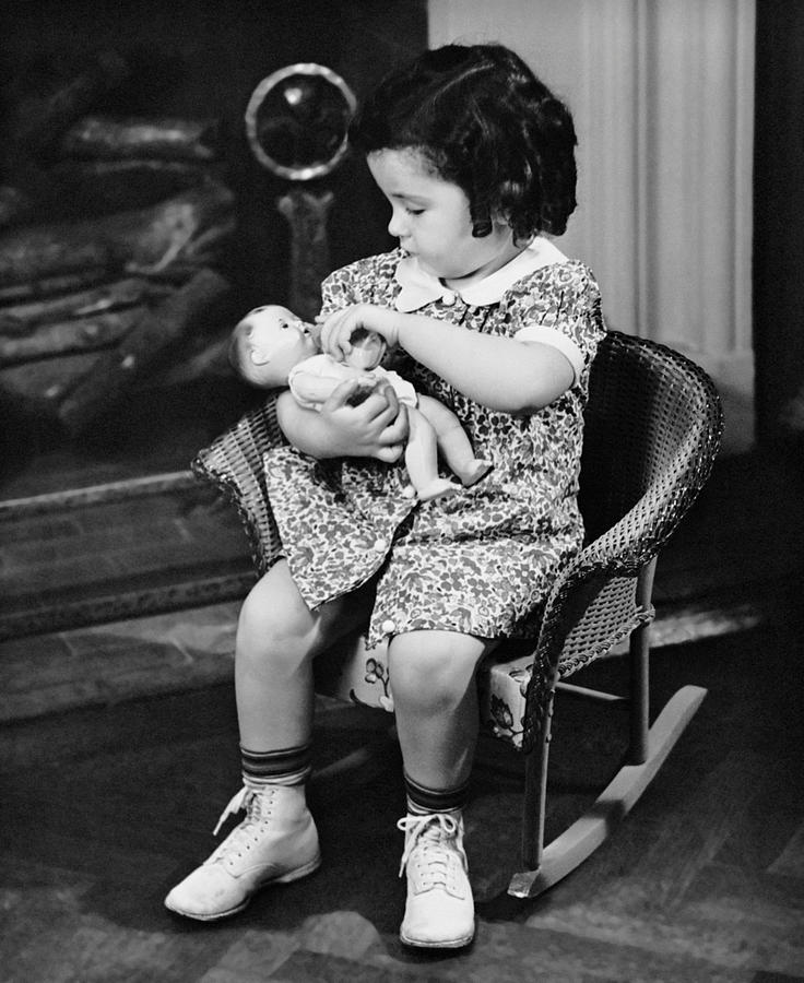 Child Photograph - Little Girl Playing With Doll by George Marks