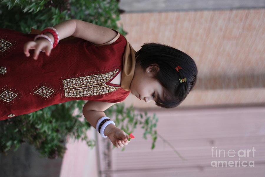 Kid Photograph - Little Girl With Flower by Muhammad Junaid Rashid