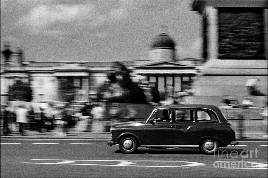 Black Cab Photograph - London Cab In Trafalgar Square by Aldo Cervato