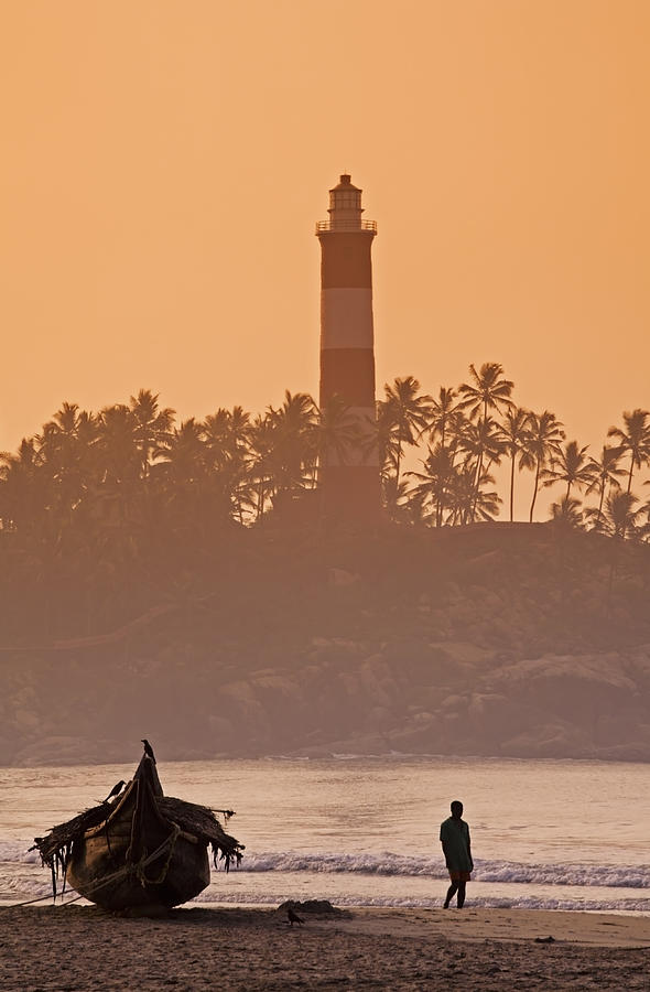 Adult Photograph - Lone Person Walking Along Lighthouse Beach In Early Morning by Anders Blomqvist