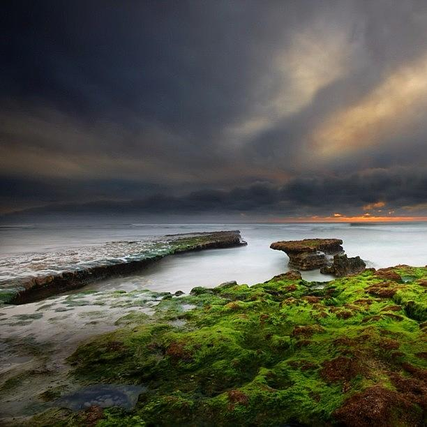 Long Exposure Of A Stormy Sunset At A Photograph by Larry Marshall