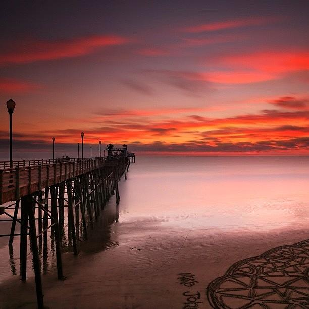 Long Exposure Sunset At The Oceanside Photograph by Larry Marshall