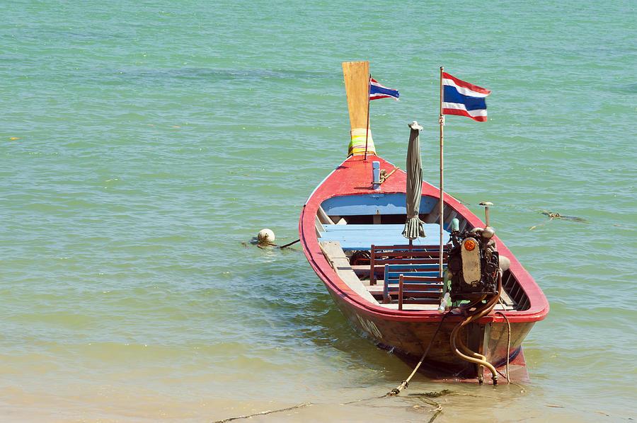 Bill Brennan Photograph - Longtail Boat At Sea by Bill Brennan