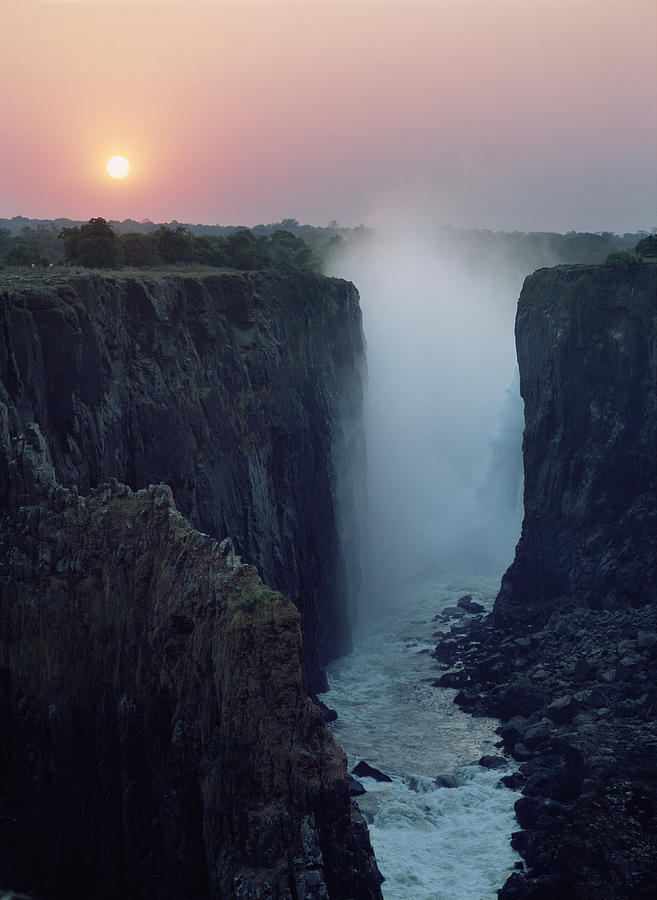Waterfall Photograph - Looking Along Victoria Falls At Dusk by Axiom Photographic