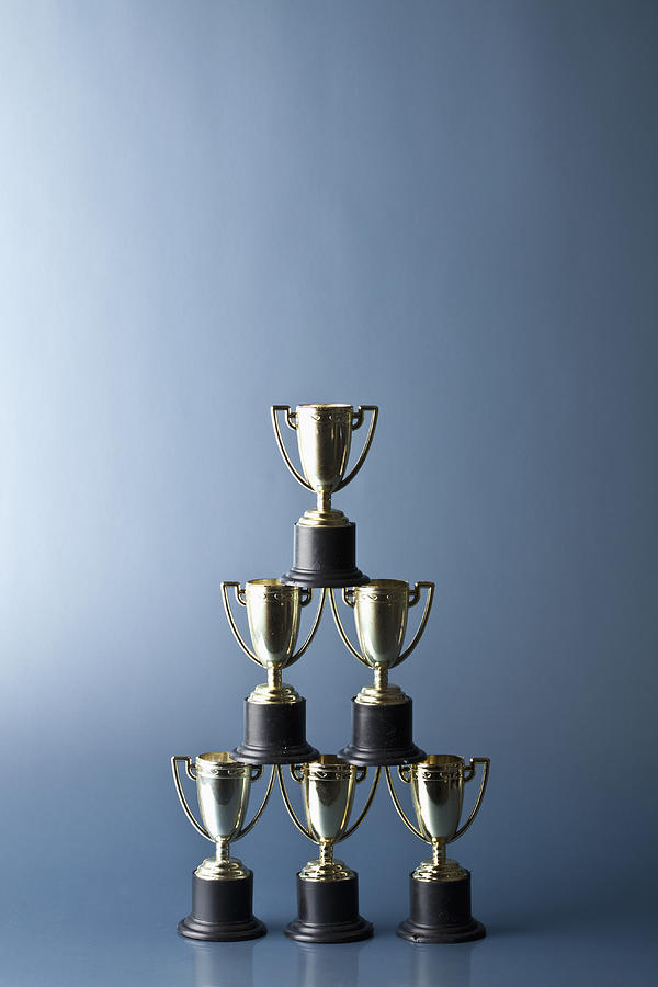 Vertical Photograph - Loving Cup Trophies Stacked In A Pyramid by Larry Washburn