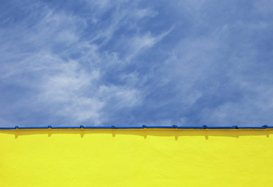 Horizontal Photograph - Low Angle Close Up View Of A Wall And Sky by Sean Russell